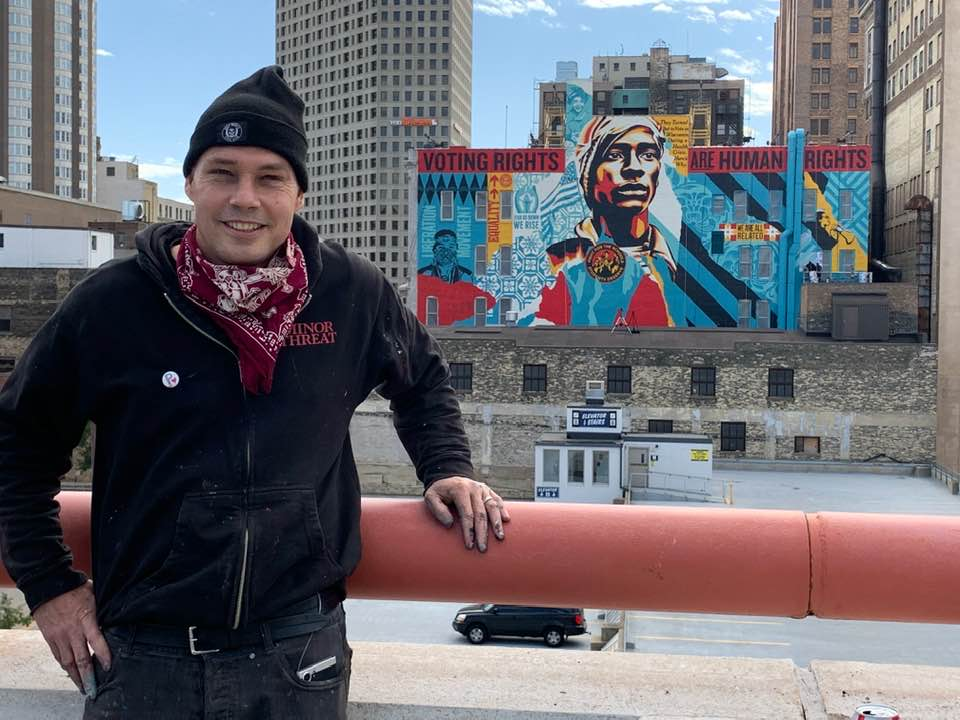 Shepard Fairey in front of Voting Rights are Human Rights