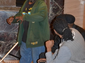 Poet Mario Willis performs most of his poem from the audience.