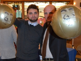 Alderman Kovac and Newaukee president Ian Abston display the Bronze Fonze beach balls used during Adam Carr's 100 Bronze Fonz Boulevard proposal.