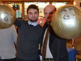 Alderman Kovac and Newaukee president Ian Abston display the Bronze Fonze beach balls used during Adam Carr's 100 Bronze Fonz Boulevard proposal.