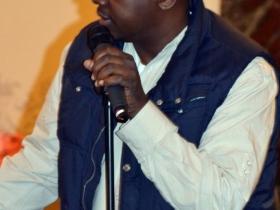 Kwabena Antoine Nixon warms up the stage.