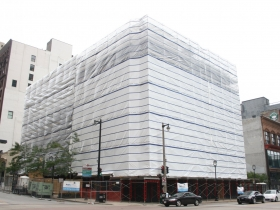Plastic Wrapped Iron Block Building