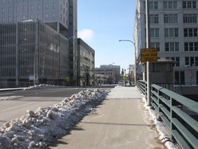 A bridge over the river at Michigan Street brought development