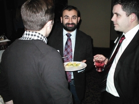 Democratic Party of Milwaukee County Chairman Sachin Chheda samples some appetizers.