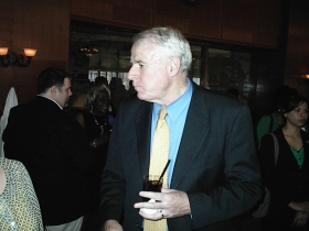 Mayor Barrett looks around at the Gwen Moore birthday party.