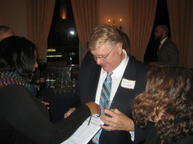 Gary Goyke signs Rebecca Dallet's nomination papers.