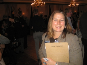 Laura Gramling Perez has her nomination papers in a clipboard from Nation Consulting. Photo by Michael Horne.