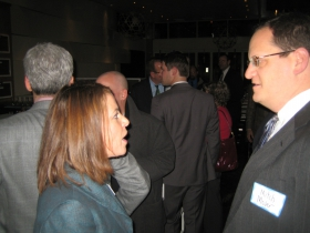 Judge Rebecca Dallet chats with Mitch Moser at her Unami Moto fundraiser. Photo by Michael Horne.