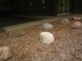 A pile of rocks in a brick bed at 795 N. Van Buren St. Photo by Michael Horne.