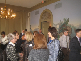 Linda Mellowes (l) faces Journal Sentinel publisher and new downtown resident Betsy Brenner (r) while real estate reporter Tom Daykin heads past the decorative wallpaper so reminiscent of the Jean Zuber et Cie hangings in the White House Diplomatic Reception Room. Photo by Michael Horne.