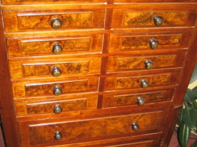 This remarkable clerk's cabinet with burled Walnut veneer drawer fronts sits in the office of the Common Council President. It very likely predates City Hall. The drawers were made with hand tools, and were not machine-made.