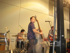Strumming the bass.