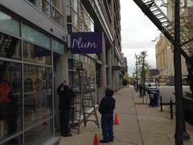 The sign going up at Plum