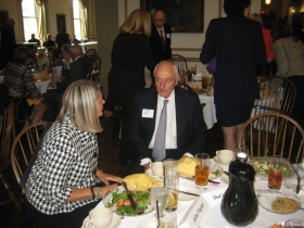 GMC CEO and House Confidential honoree Julia Taylor chats with Sheldon Lubar at the group's monthly meeting. Photo by Michael Horne.