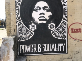 Shepard Fairey Power & Equality poster and a tag by Free Humanity on a building at 320 E. Clybourn St.