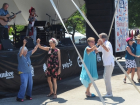 People dance to Robin Pluer at Bastille Days