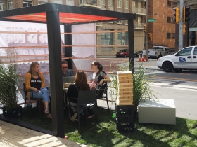People sit at the Rinka Chung Architecture parklet