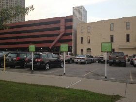 Three new ZipCar spots, located in the parking lot at the corner of Broadway and Michigan St. Photo by Mariiana Tzotcheva.