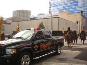 Sheriff David A. Clarke Jr., as usual, rides on his horse sporting a cowboy hat in the parade.
