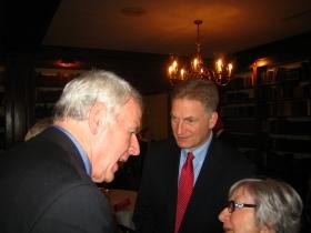 Tom Barrett, Sheldon Wasserman, and a supporter chat during a Lassa fundraiser.