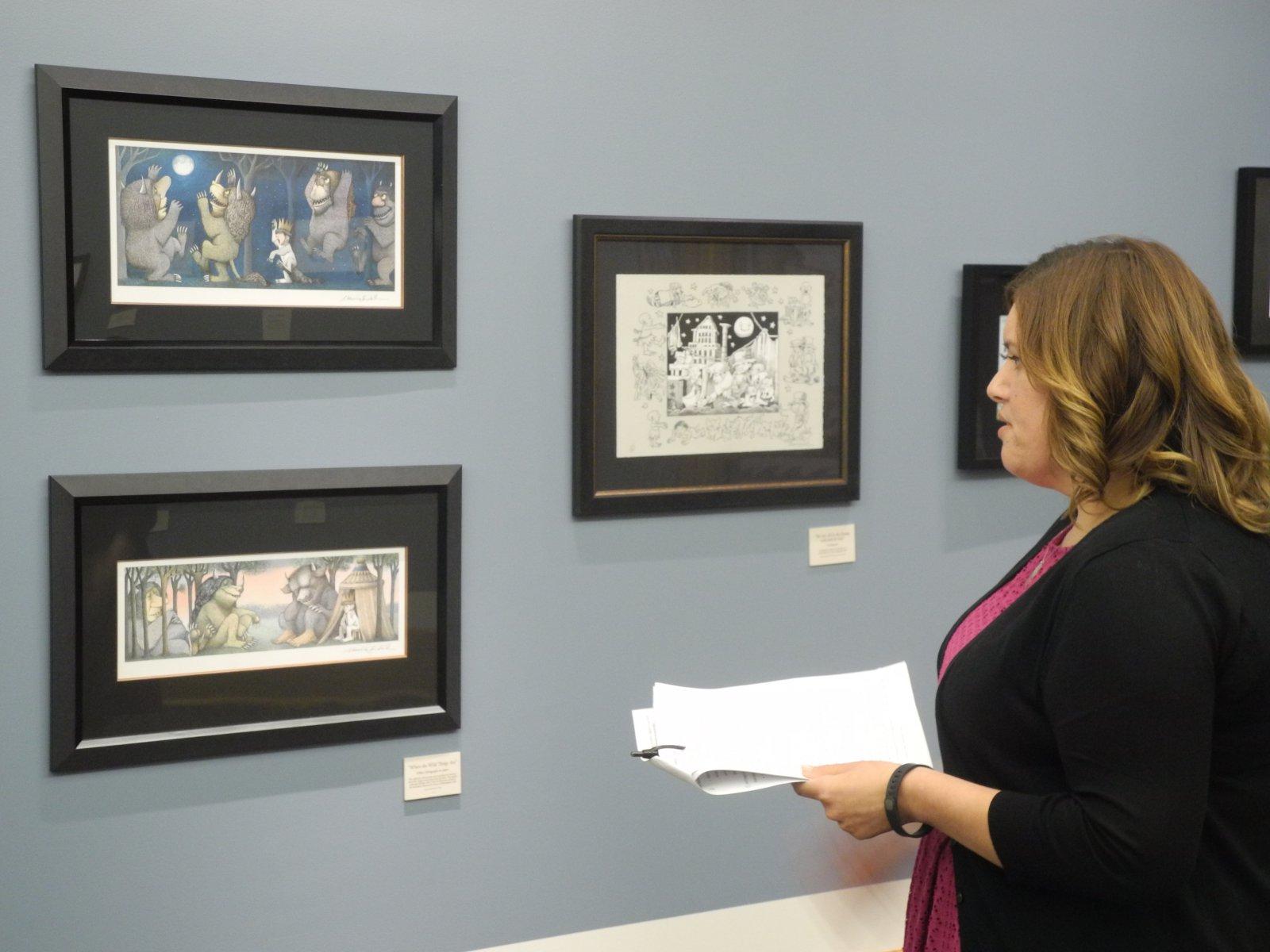 Librarian Christina Gomez giving a tour of the exhibition.
