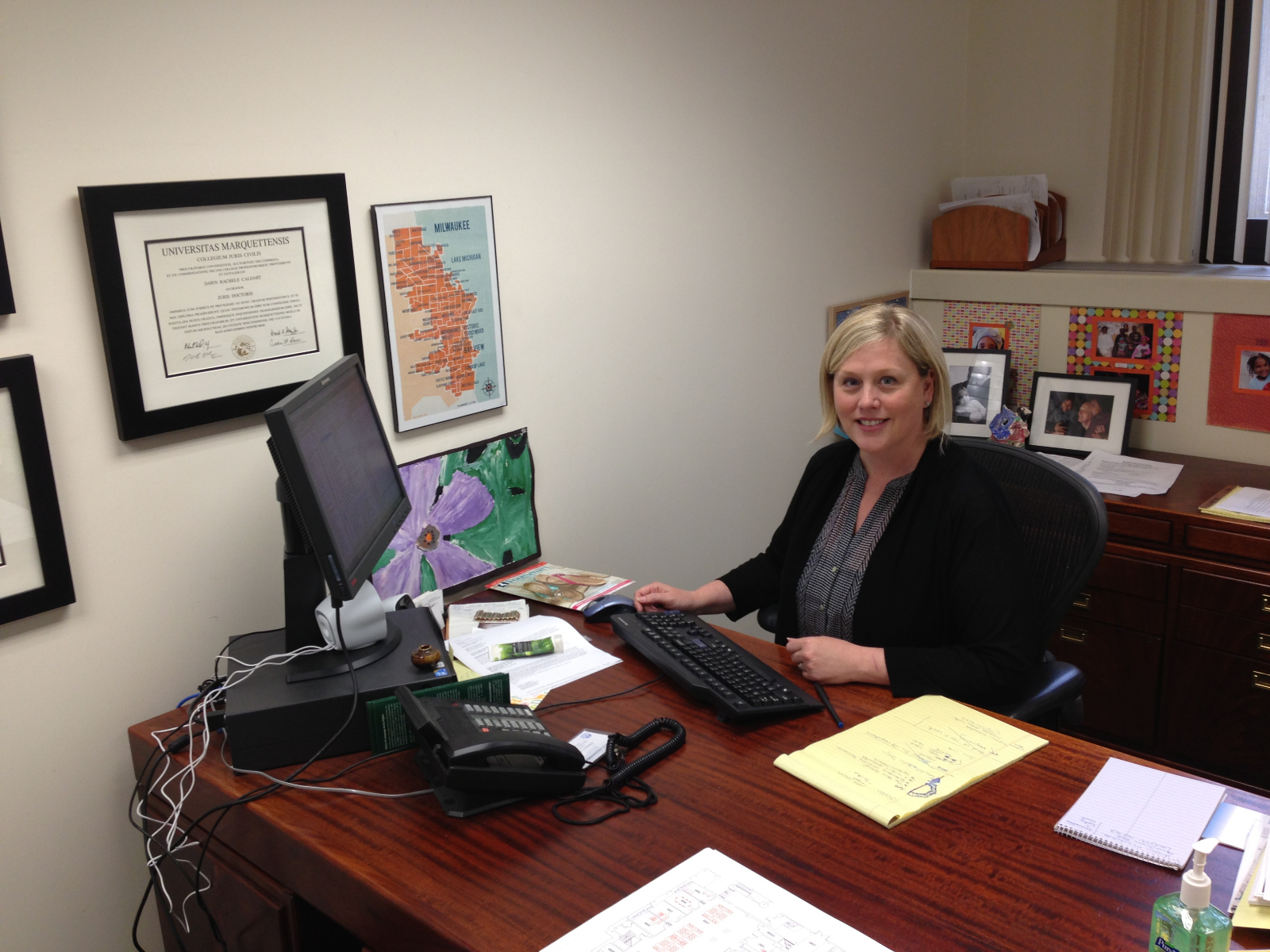 Executive director Dawn Caldart sits at her desk at the Milwaukee Justice Center.