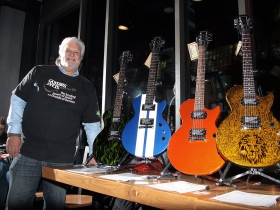 Volunteer, Ron Vianes with donated guitars at the