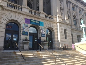 The outside of the Milwaukee Central Library on Wisconsin Ave is currently hosting a Maurice Sendak showcase.