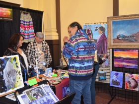 Artist Christoper Sweets' booth at the Hunting Moon Pow Wow 2018