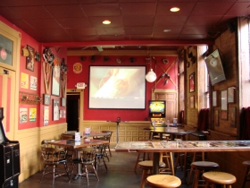 Back of the bar with projection screen.
