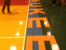 Milwaukee painted on the basketball court.