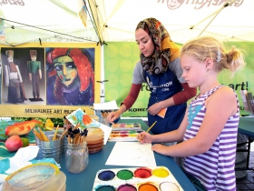 The Kohl's Color Wheels tent, Team Coordinator Liala Amin, and Lucy Klassen, from Milwaukee