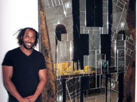 Artist Rashid Johnson and his Falling Man, 2016 work made of burned red oak, black soap, wax, mirrored tile and spray enamel