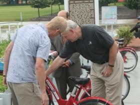 Barry Mainwood helps Tom Barrett unlock a bike.