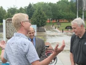 Barry Mainwood showing the bike-sharing system to Mayor Barrett.