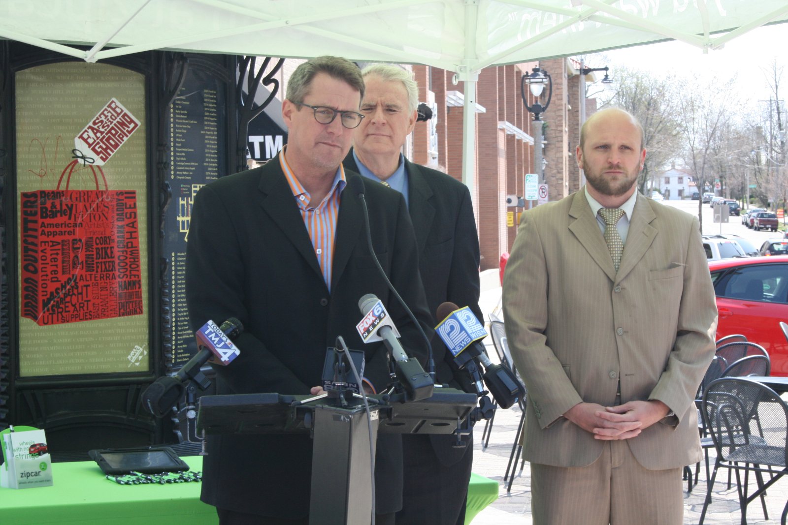 Jim Plaisted speaking at the ZipCar press conference.