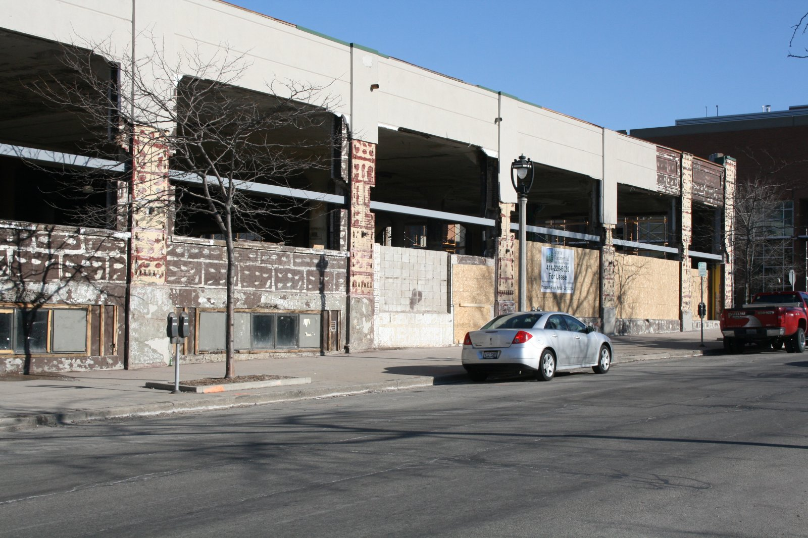 Construction at the former Prospect Mall as the auto dealership turned mall is being converted to a mixed-use apartment building.