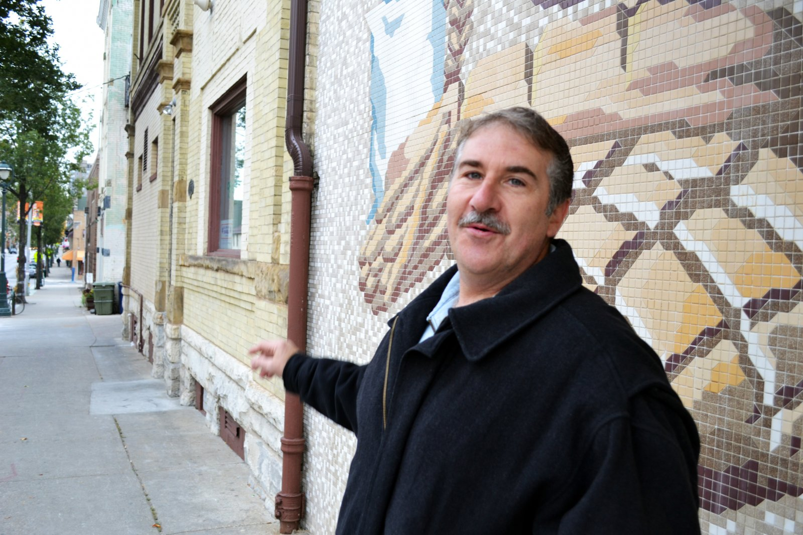 Frank explains the Italian and Polish hertitage in the neighborhood in front of Scortino\'s Bakery