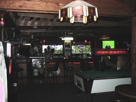 There are a number of attractive handmade lighting fixtures in the tavern. The front pool table, seen here, is close to the bar. Photo by Michael Horne