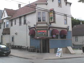Scaffidi's is a classic example of a Milwaukee corner tavern with family living quarters above. The fan on the wall dates to a time when it served food from a now-closed kitchen. Photo by Michael Horne