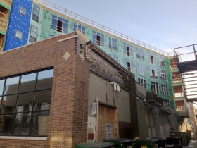 A view of construction of Prospect Mall Apartments from the alley.