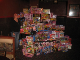 Germaine Bowers with Christmas Gifts for Journey House Kids.