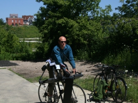 Ald. Kovac arrives in style, by bike.