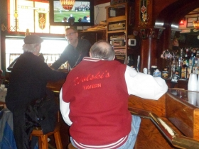 "Doc Sheahan, Tom ""Wags"" Wagner sit at the bar while Paul ""PJ"" Johnson works behind bar. Photo taken February 23rd, 2013 by Audrey Jean Posten."
