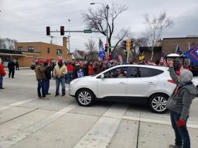 Members of the Trump rally block traffic