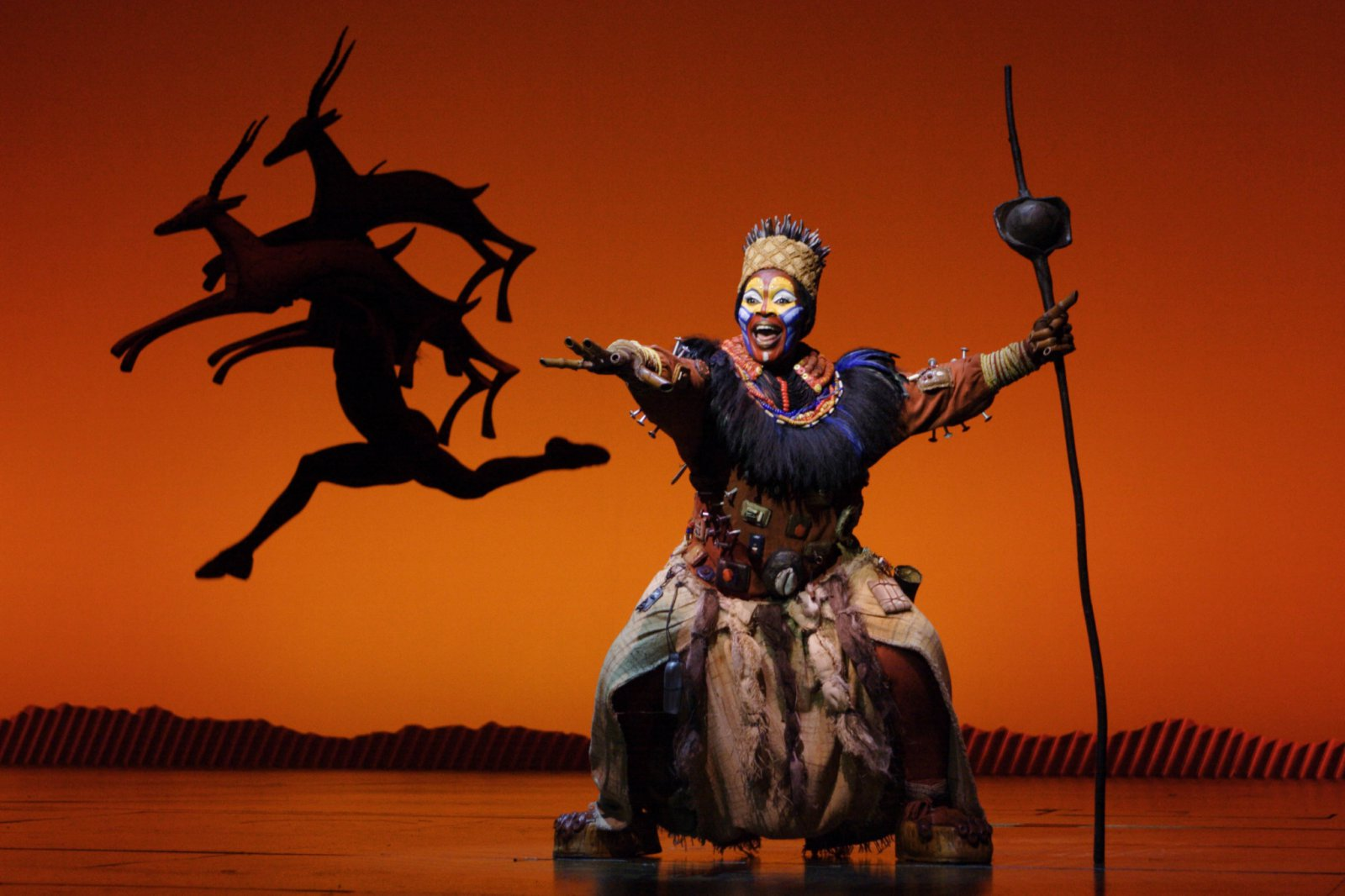 Brown Lindiwe Mkhize as Rafiki in the opening number The Circle of Life from THE LION KING National Tour.