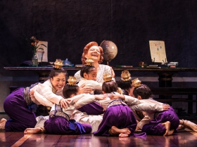 Angela Baumgardner as Anna Leonowens and the royal children in Rodgers & Hammerstein's The King and I