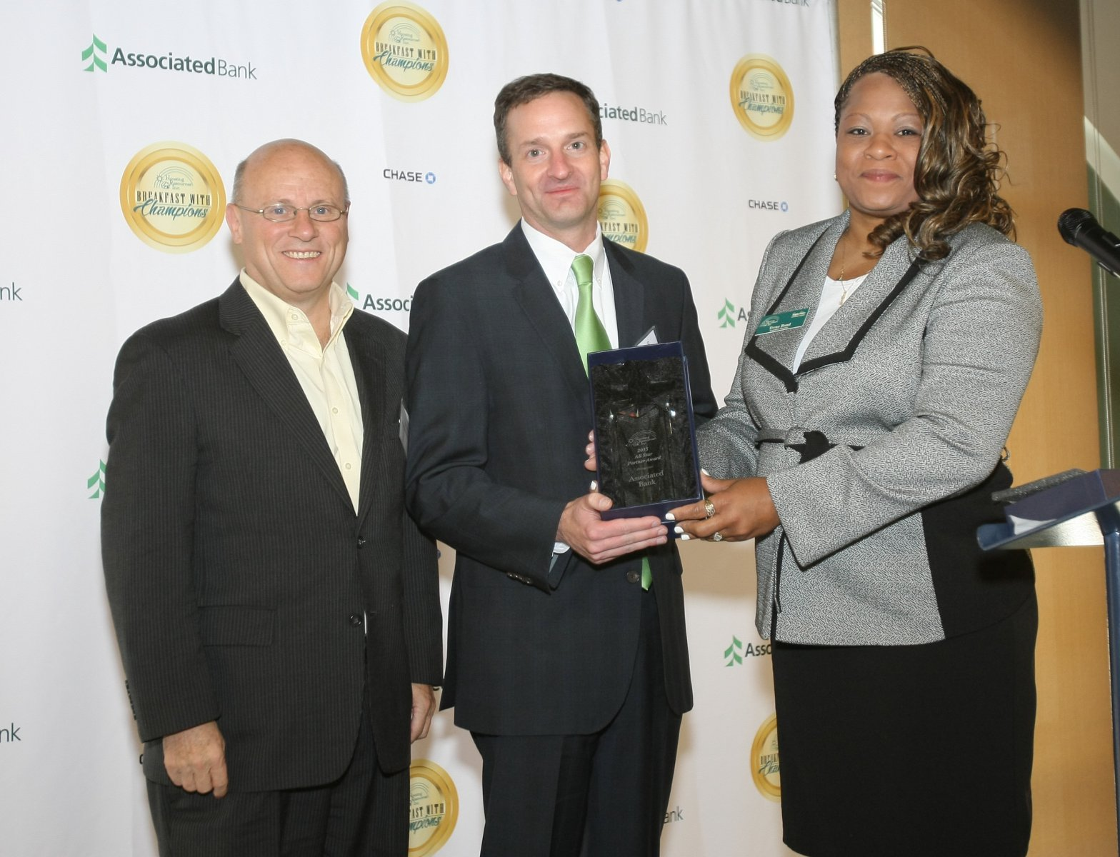 """NeighborWorks America President and CEO Paul Weech, Associated Bank Executive Vice President and Chief Marketing Officer Christopher Piotrowski, and Housing Resources, Inc. Executive Director Trena Bond at the Housing Resources, Inc. """"Breakfast with Champions"""" event"""
