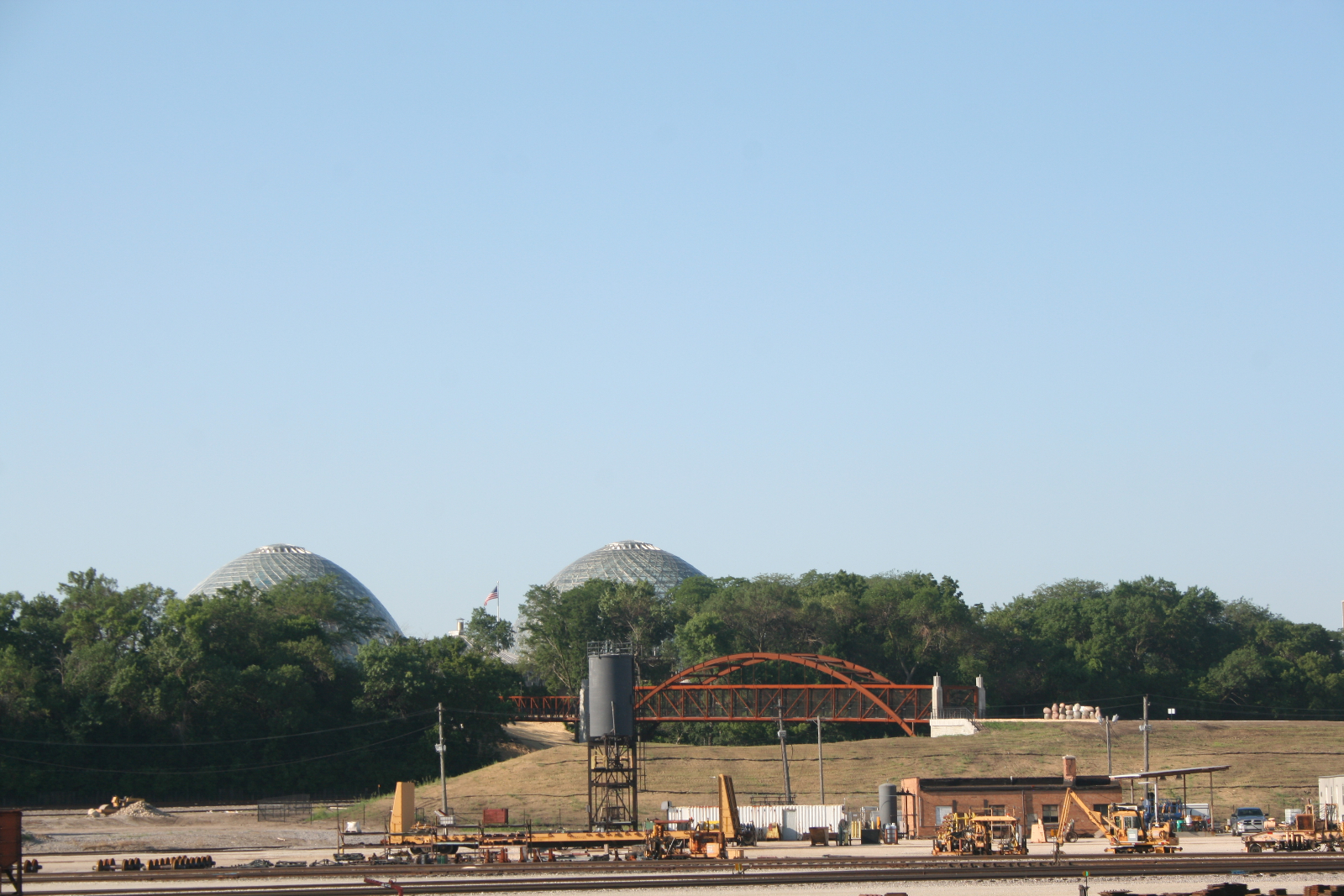 A view of one of the new bridges at Three Bridges Park, with the Domes in the background.