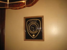 Clock fashioned from a Milwaukee Police Department emblem